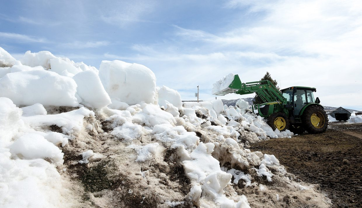 Rancher Jim Stanko moves snow on his ranch just outside of Steamboat Springs. The rancher wanted to make sure his driveway was clear and ready for spring.