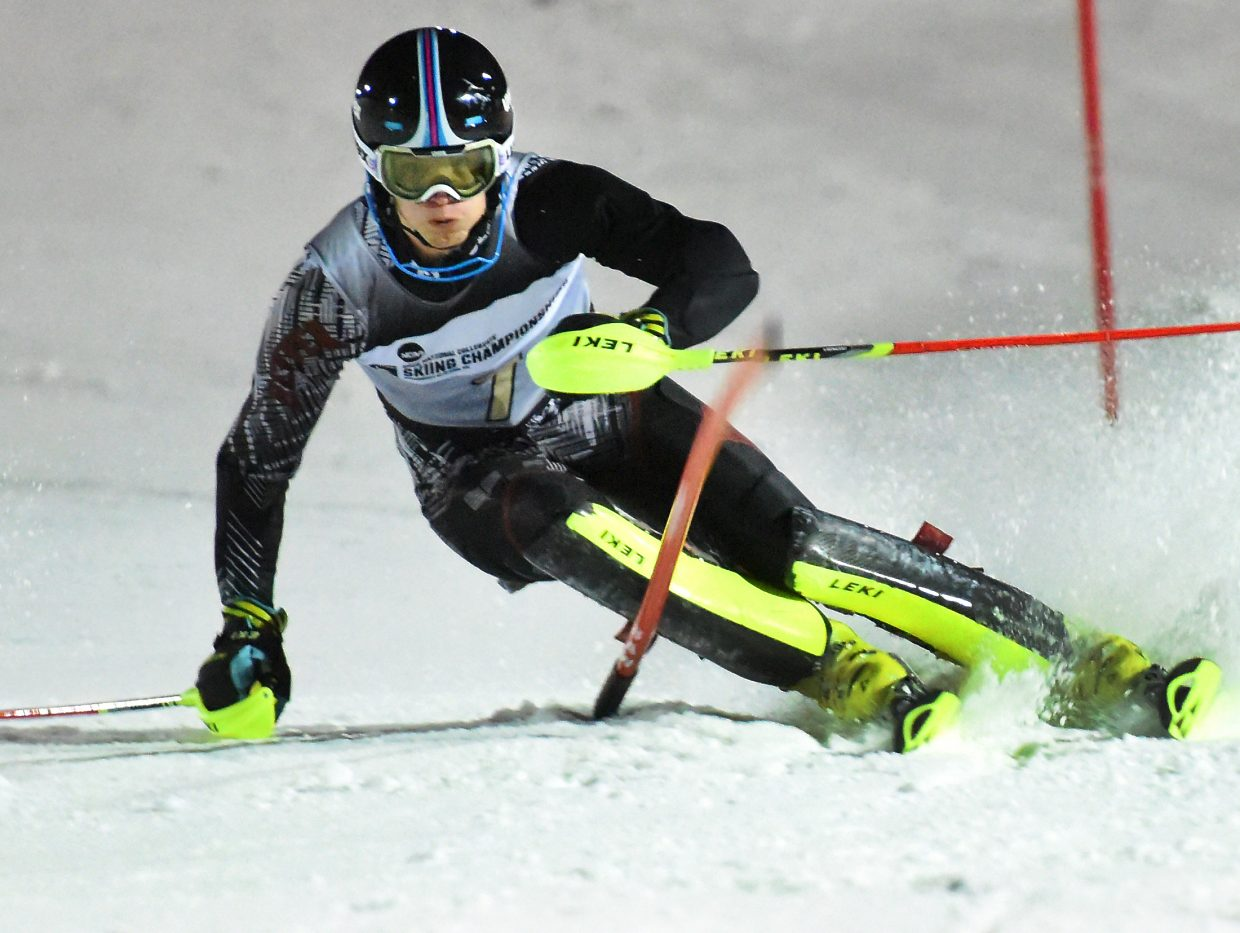 University of Denver skier Erik Read plows through the slalom course at Howelsen Hill on Friday on his way to winning a NCAA championship in the event. His win helped lift the Pioneers into first place in the team standings heading into the final day of competition.