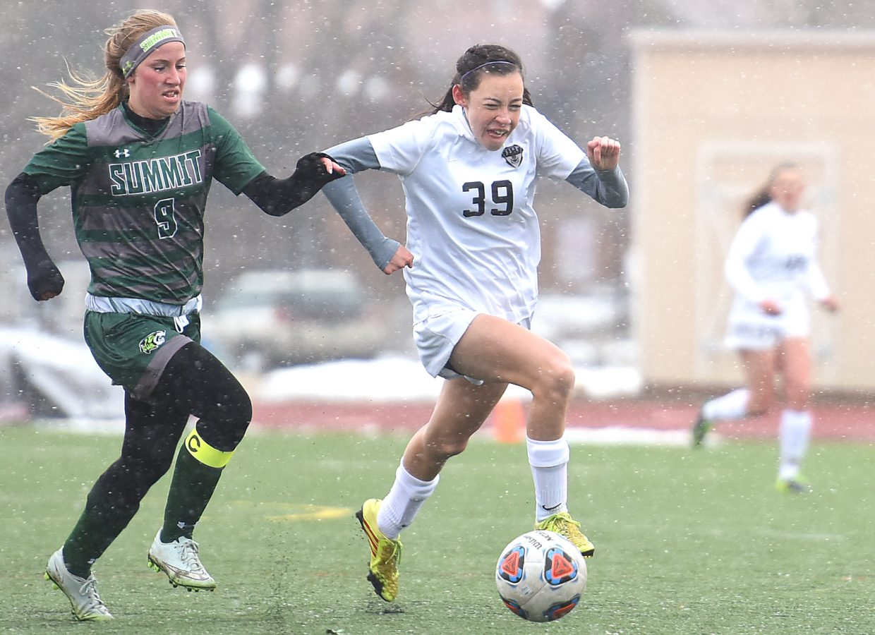Steamboat's Rachele Koly races down the field Tuesday against Summit.