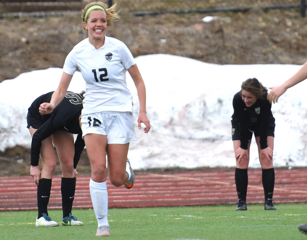 Steamboat senior Natalie Bohlmann celebrates after dishing an assist on a goal in a 5-0 win against Battle Mountain.