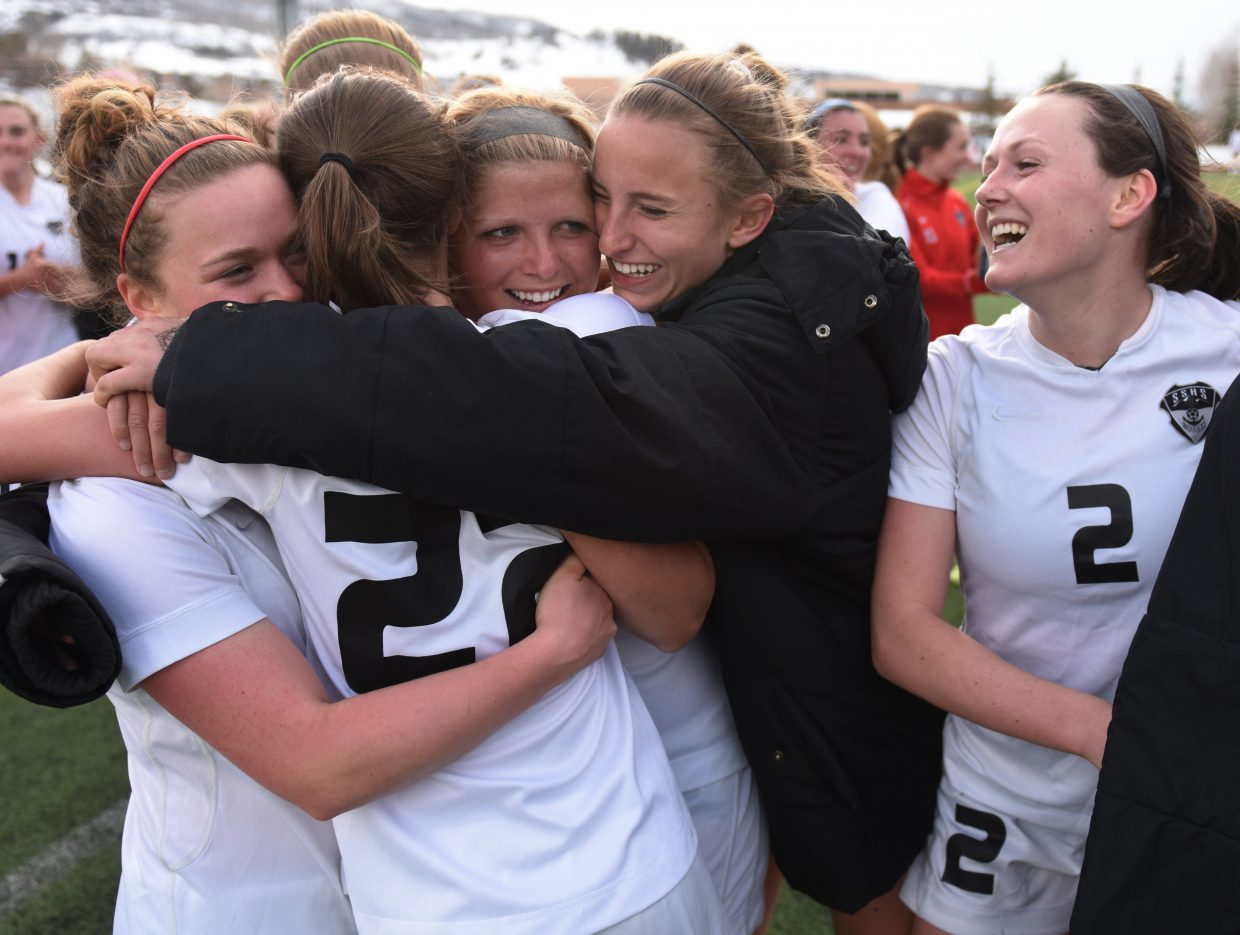 Members of the Steamboat Springs High School girls soccer team celebrate on Tuesday after finishing off a 5-0 win against rival Battle Mountain. Steamboat handed the Huskies their first league loss in nearly two years.