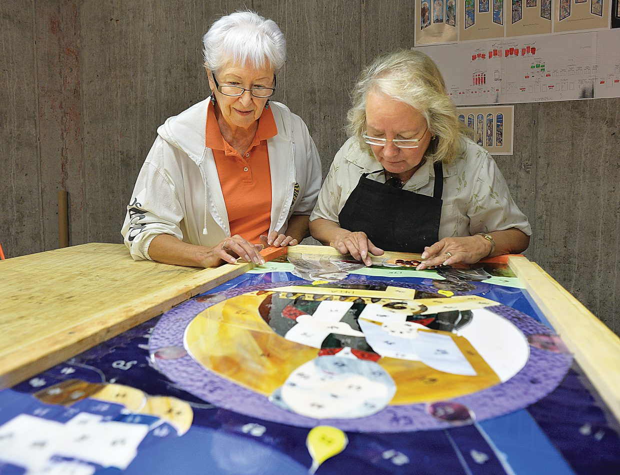 Jane Grogan, left, and Shirley Stocks work on one of the many stained glass windows that volunteers are creating for the new Holy Name Cathloic Church in downtown Steamboat Springs.
