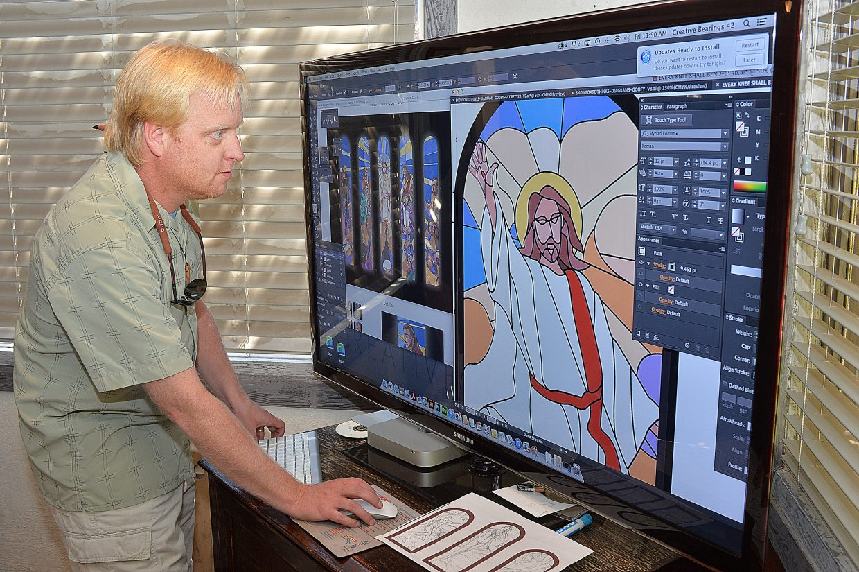 Steamboat Springs artist and owner of Creative Bearings, Greg Effinger works on one of the many stained glass windows he has helped create for the Holy Name Catholic Church. When the project is done every window in the building will be filled with stained glass.