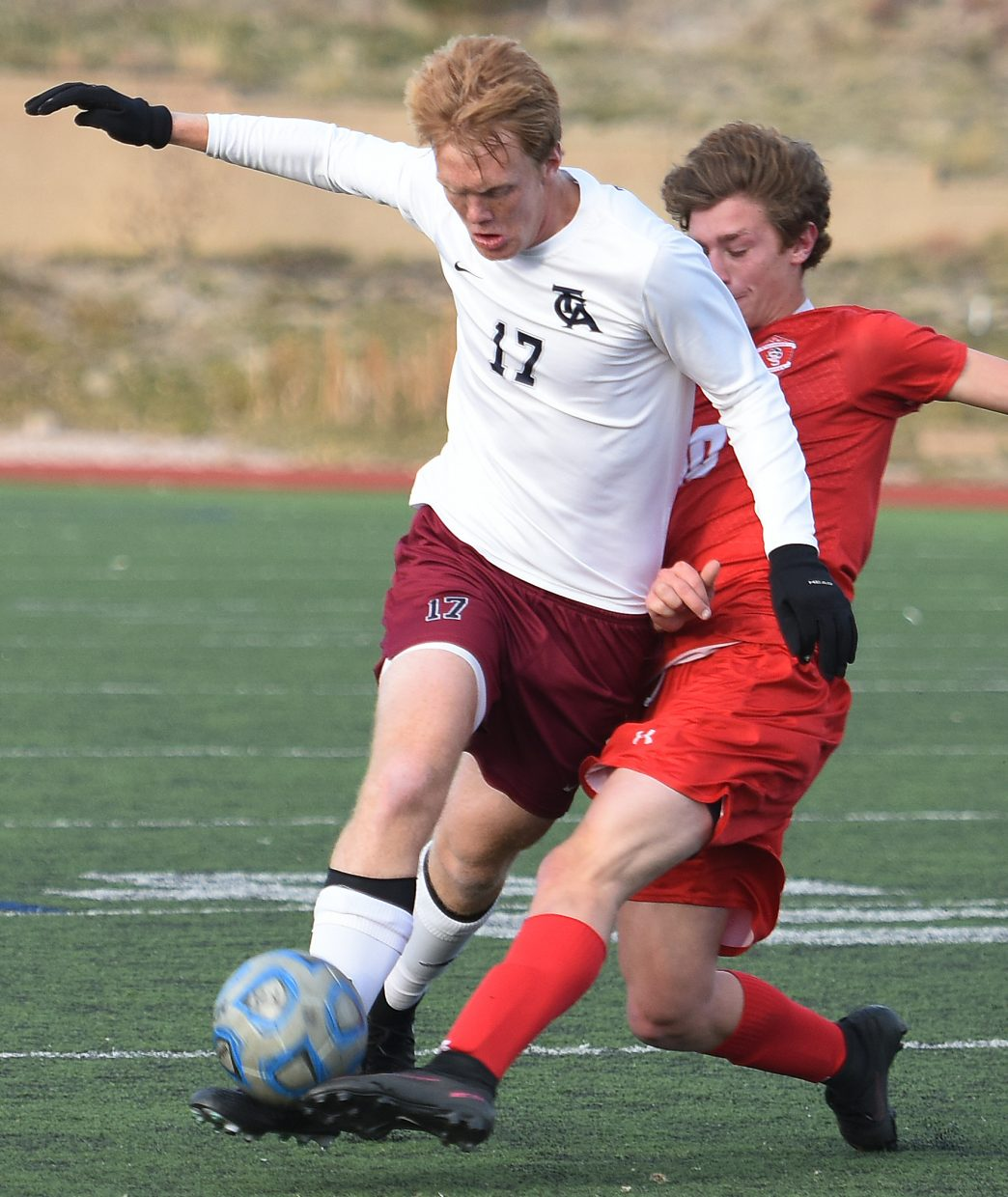 Steamboat's Quinn Connell gets physical with The Classical Academy's Jonny Stephens on Tuesday in the second round of the Class 4A state playoffs.