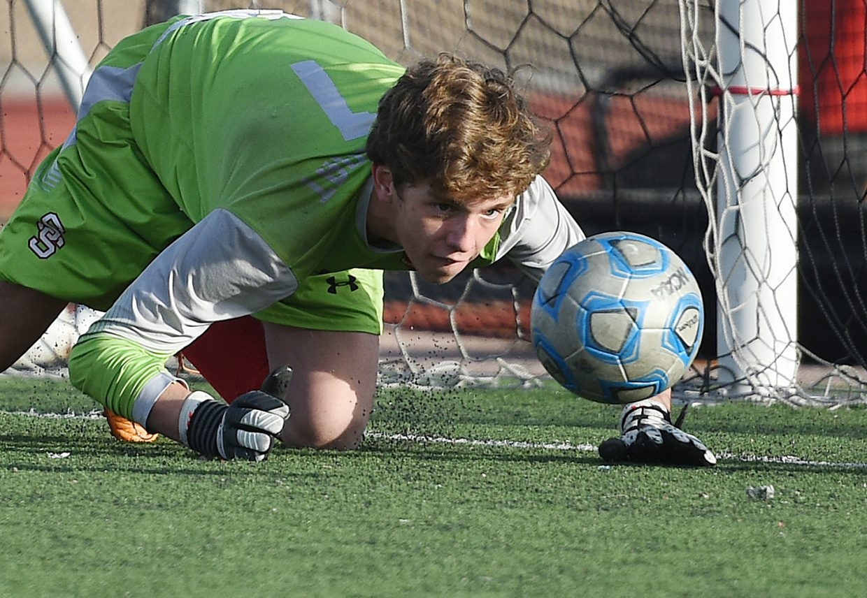 Steamboat goalkeeper Cruz Erickson tries to chase down a ball after he knocked it down in front of the goal on Tuesday as the Sailors played The Classical Academy in the second round of the Class 4A state playoffs. Erickson got there, scooping the ball up to prevent a goal.