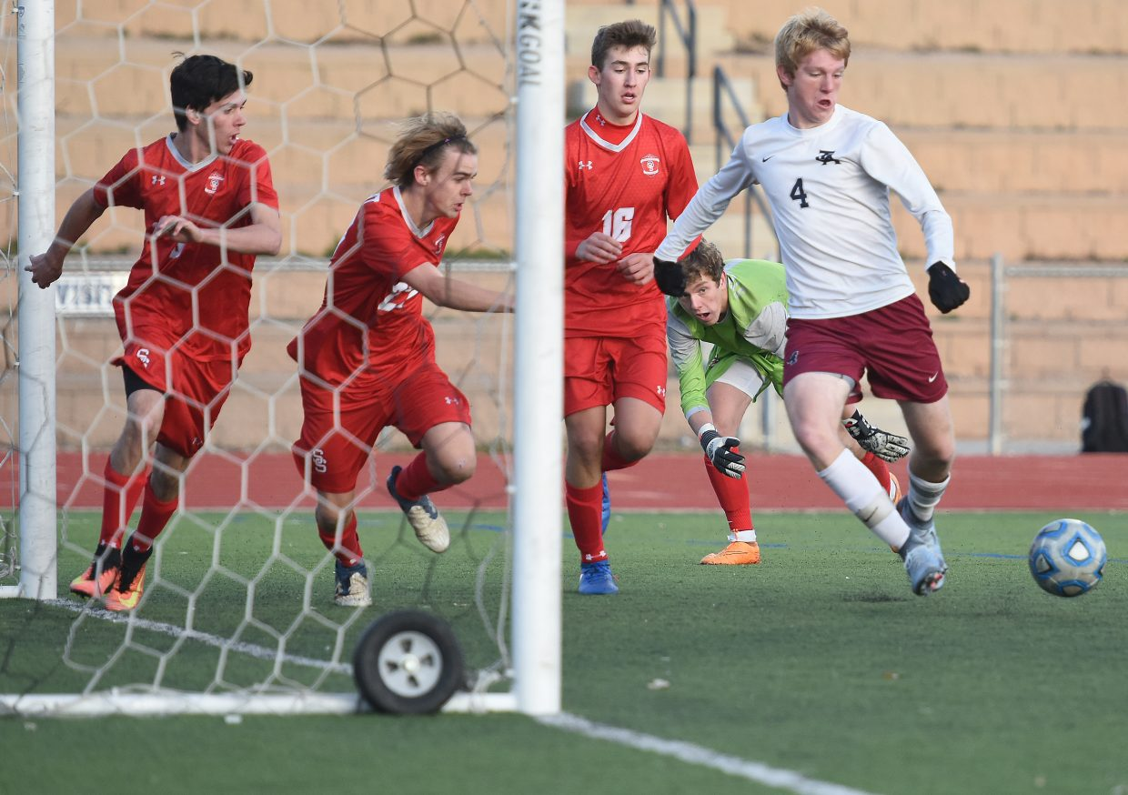 The Steamboat defense scrambles to get in front of The Classical Academy senior Jake Slater during Tuesday's second-round Class 4A state playoff game in Colorado Springs. Slater weaved his way through that defense to score on the play, one of two goals he had in what was a 4-0 victory for his squad.