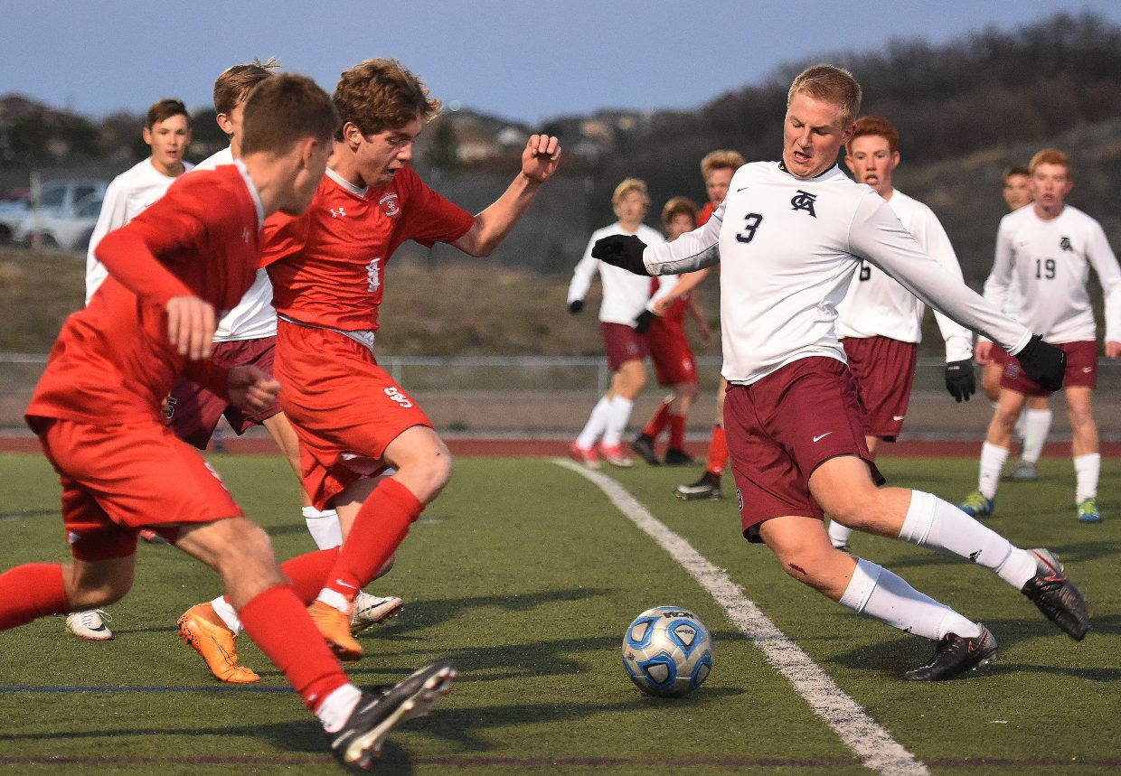Steamboat's Cruz Erickson and The Classical Academy's Daniel Borchert charge toward a ball Tuesday in a Class 4A second-round playoff game in Colorado Springs.