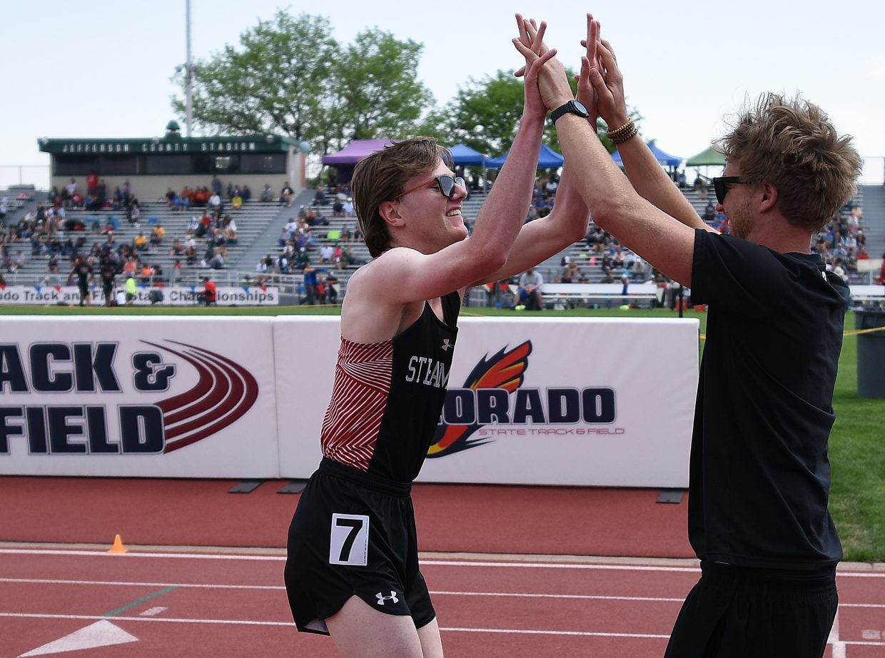 Steamboat senior Jon Ruehle puts his hands up to celebrate with former coach Erik Ramstad on Saturday at the state track meet in Lakewood.