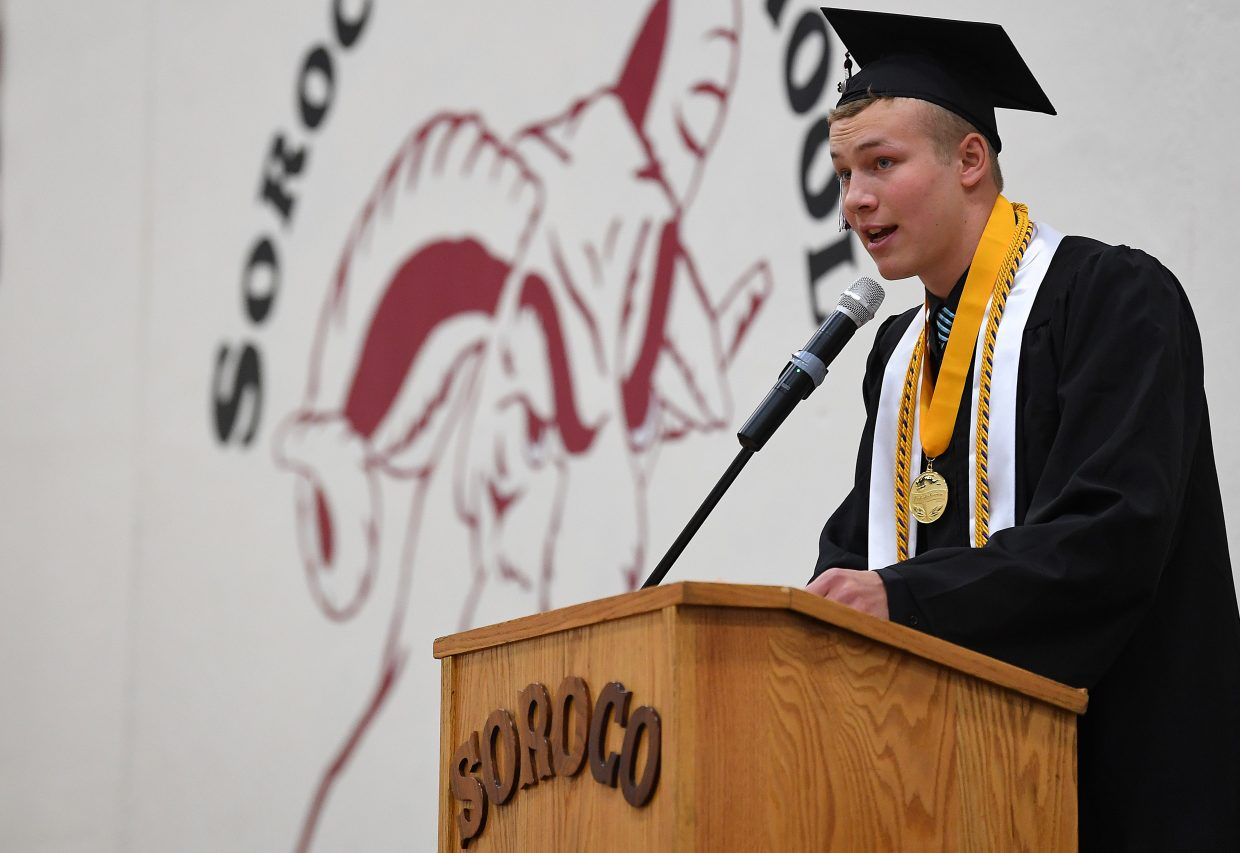 """Schuyler Carlson, co-valedictorian of the 2018 Soroco High School senior class, speaks during the graduation ceremony, urging his classmates to keep """"sending it."""""""