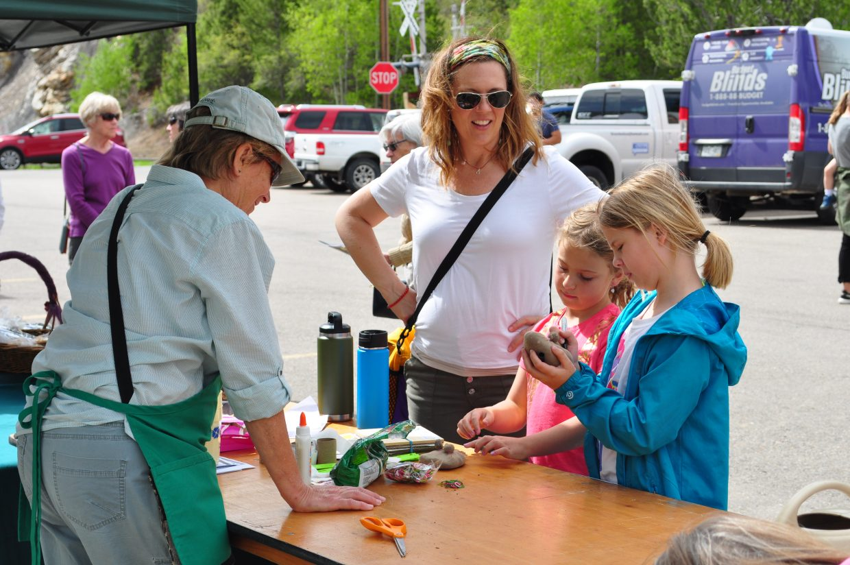 Master Gardener Jo Smith shared gardening tips to, from right, Emma, 10; Harper, 7; and Eron Haubert, from Steamboat Springs at the Home & Garden Expo which was held on Saturday.