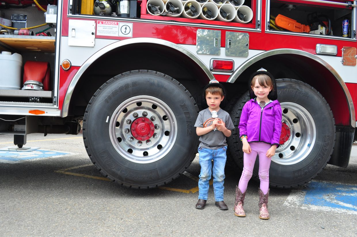 Temperance, 5, and Treyson Griebel, 3, visiting from Nebraska got to be junior firefighters at the Home & Garden Expo in Steamboat Springs on Saturday.