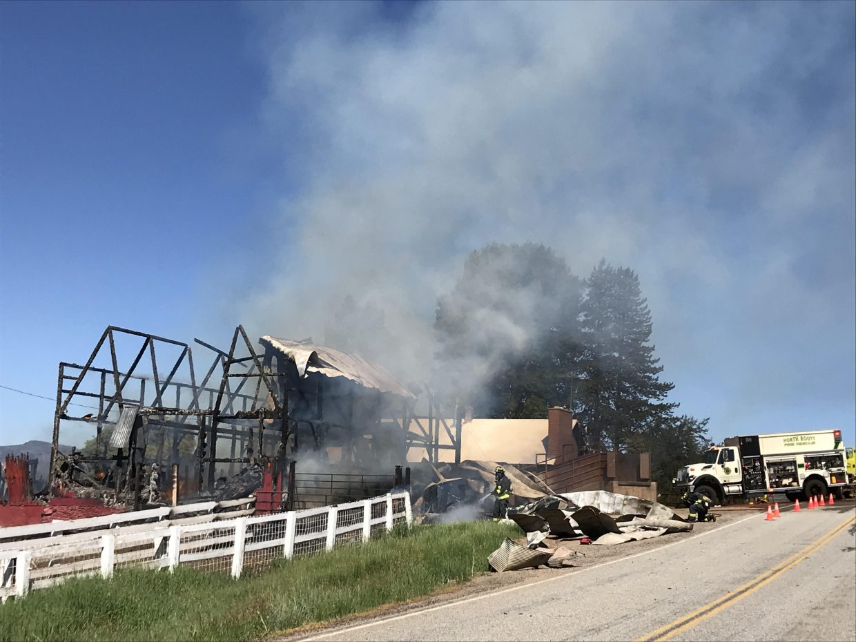 Firefighters battle a barn fire in North Routt County  Monday morning. The blaze destroyed the historic barn on the Circle Bar Ranch.