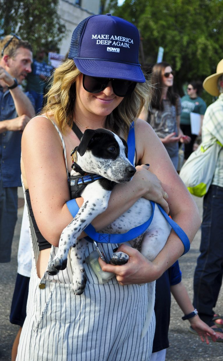 Morgan Cox and the puppy Cameo of Steamboat Springs observe the