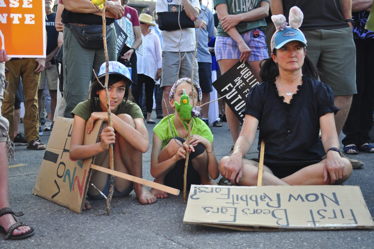 Marianne Capra, from right, and her daughters Lucy and Wren participate in the