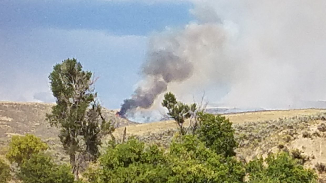 The fire west of Hayden seems to have flared up Satuday afternoon. Here's a picture from the rest area.