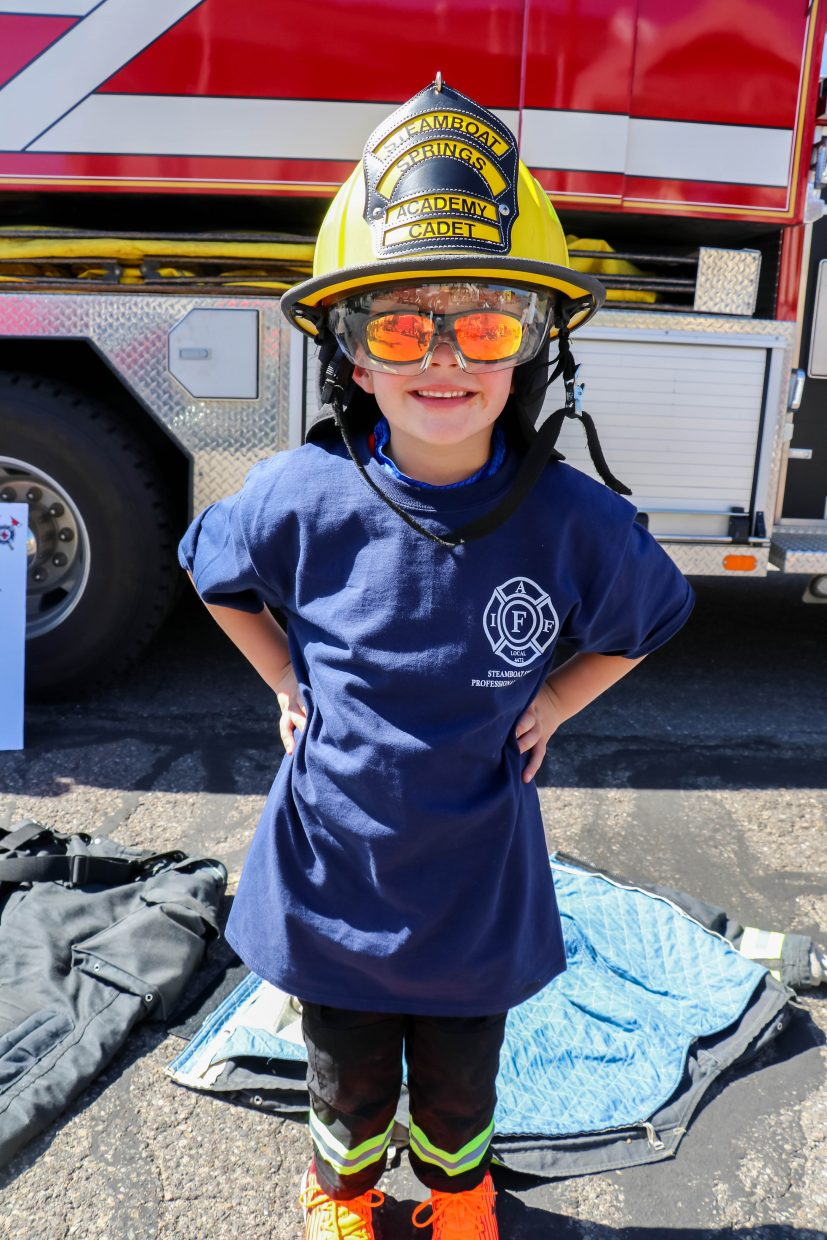 Academy Cadet Paxton Wilson trying on real fire fighter gear and ready for training at the Steamboat Springs Fire Rescue Open House.