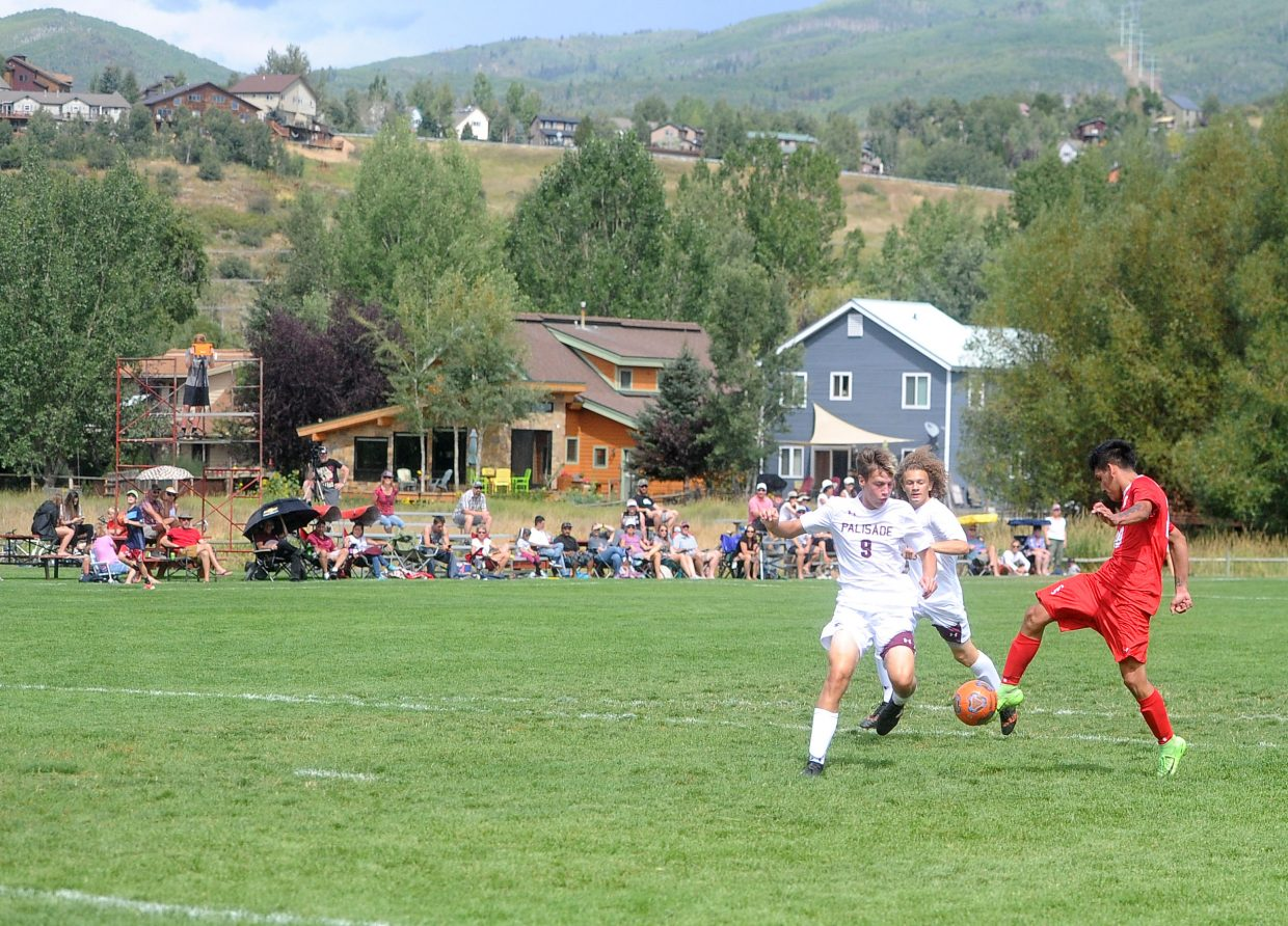 Steamboat Springs High School junior Daniel Lopez lines up a long goal against Palisade on Saturday at Dudley Field. Lopez finished with two goals.
