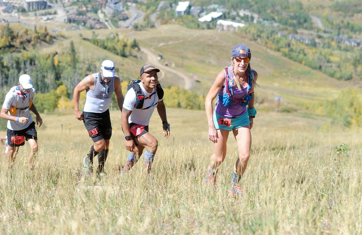 Runners in the Run Rabbit Run 100 smile as they climb Steamboat Ski Area on Friday, Sept. 14.