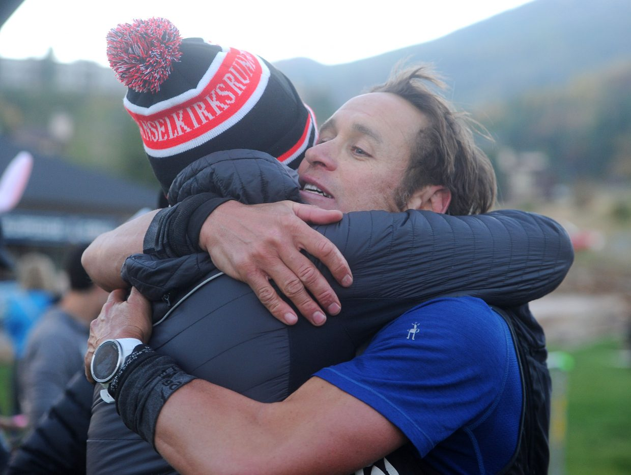 Jason Schlarb from Durango wins the Run Rabbit Run 100 hare division with a time of 18 hours, 48 minutes and 8 seconds on Saturday, Sept. 15. He embraces Mike McKnight, the athlete manager for Altra.
