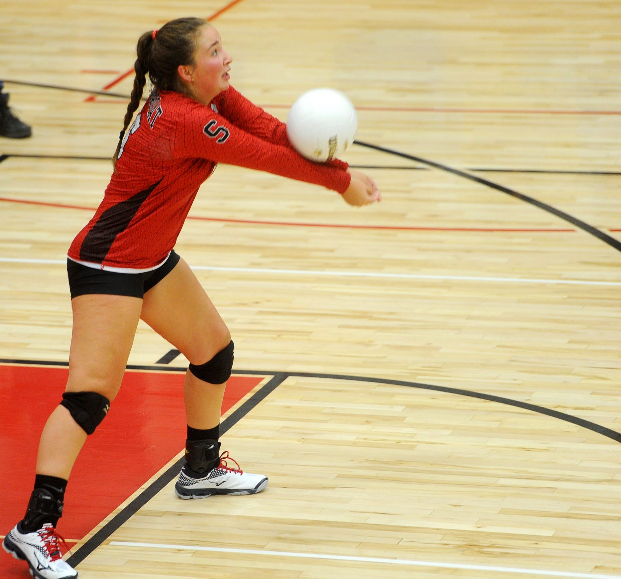 Senior libero Katelyn Kline lines up a dig against Moffat County on Aug. 23. Hall said that Kline showed consistency in her varsity tournament debut at Glenwood Springs on Aug. 31 and Sept. 1.
