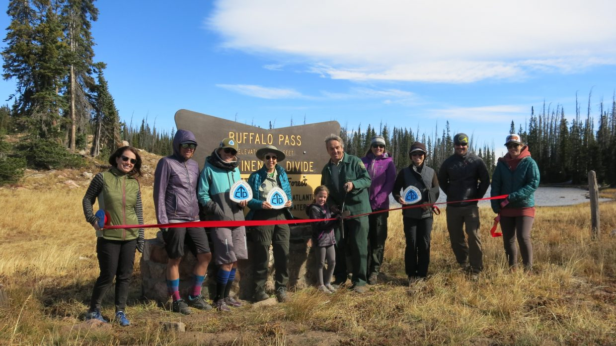 The dedication of a new Continental Divide sign at Summit Lake.