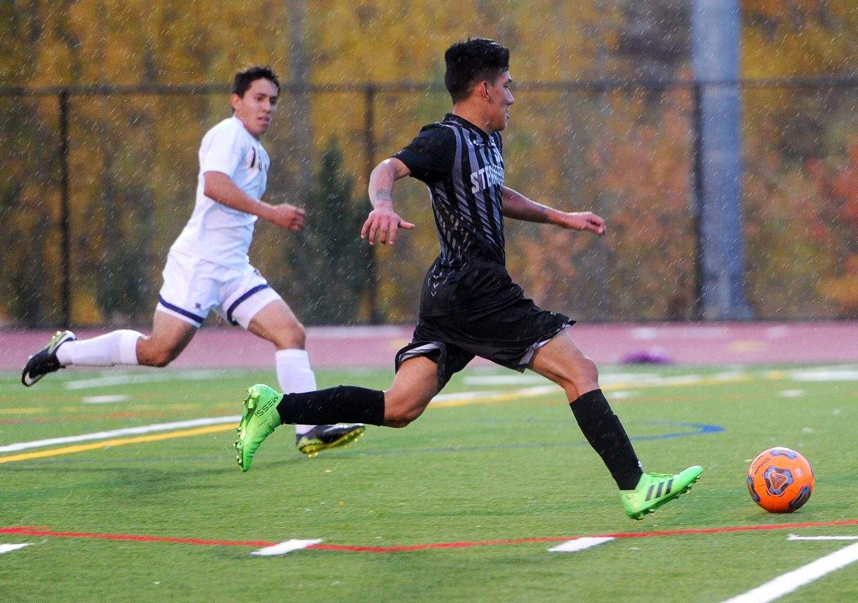 Steamboat Springs High School junior Daniel Lopez dribbles down field in the game against Rifle on Tuesday, Oct. 2 at Gardner Field.