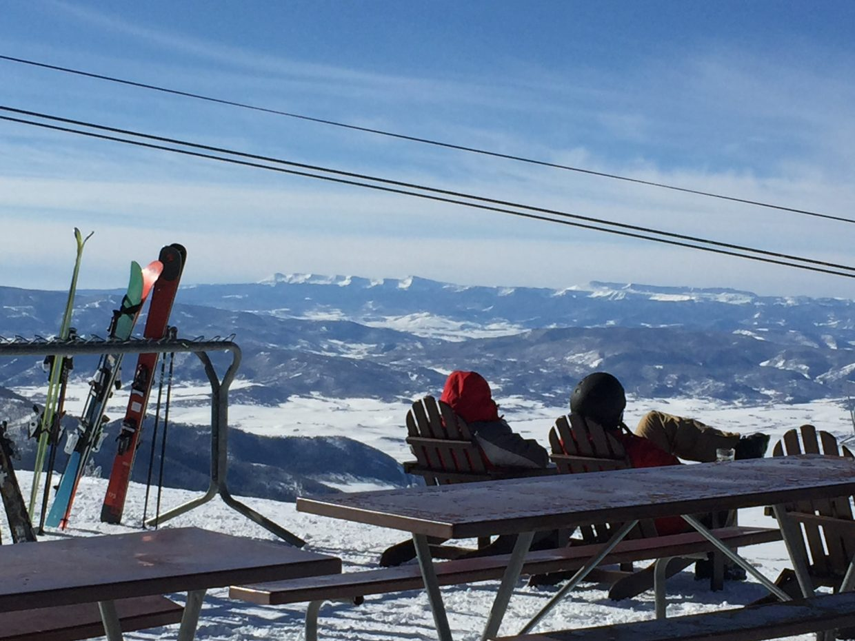 Two skiers enjoy the view at Steamboat Resort.