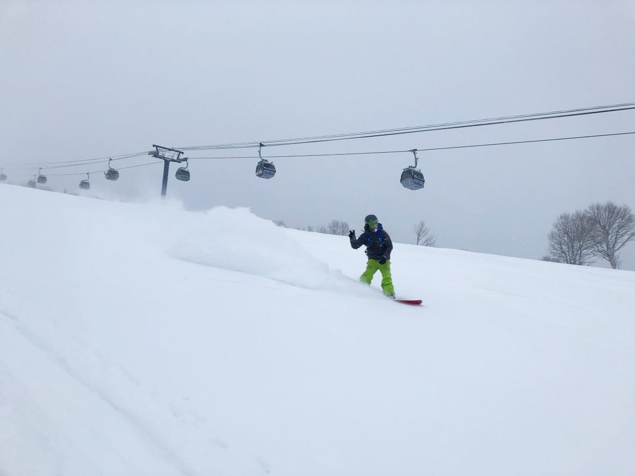 A snowboarder enjoys fresh powder at Steamboat Resort.