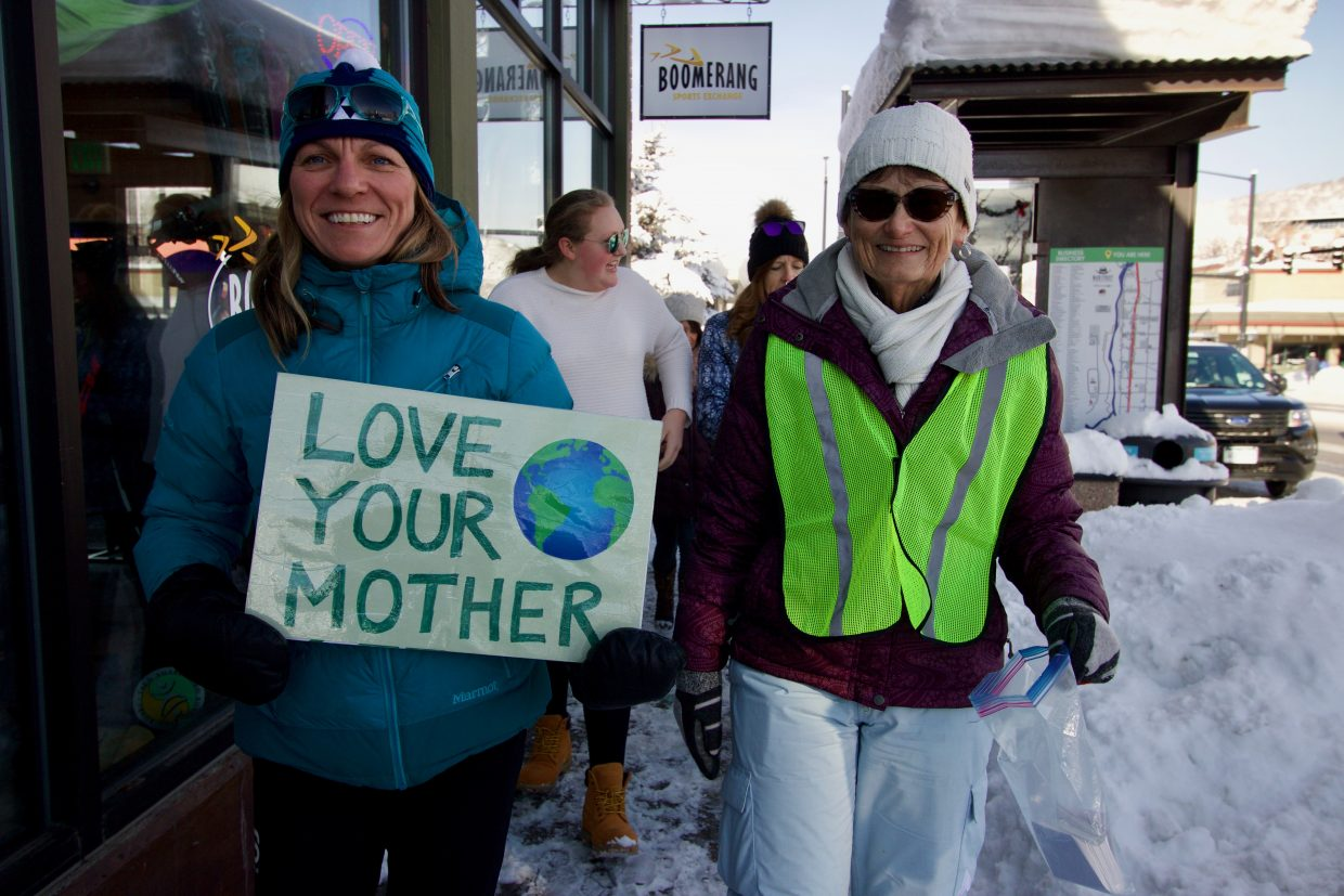 Anne Mudgett marches with her friend, Hope Cook, along Lincoln Avenue in downtown Steamboat. Mudgett, the communications and development director for Yampa Valley Sustainability Council, held up a sign championing women's rights as well as environmental stewardship.