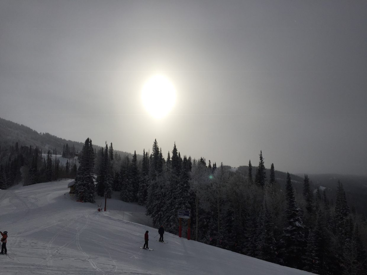 The sun hides behind thin, fog-like clouds at Steamboat Resort.