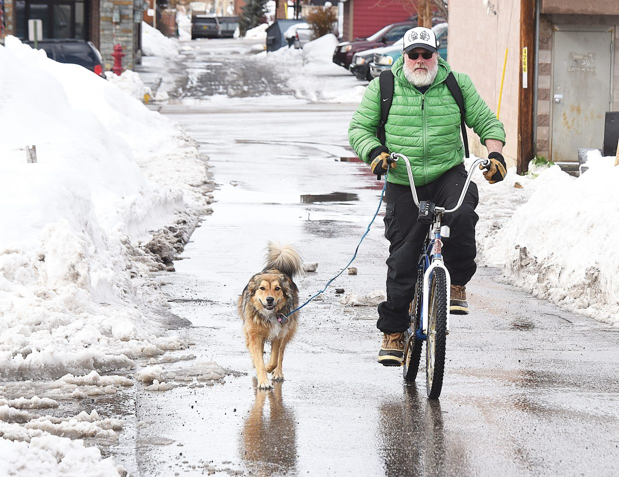 Chris Garrison and his dog angel make thier way through an alley in downtown Steambaot Springs.
