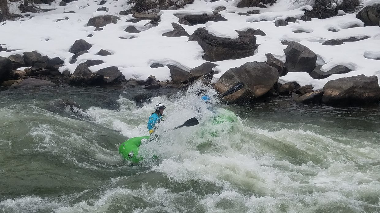 Boatwoman Kirsten Lovas getting a good hit in Maneater Rapid on the Shoshone section of the Colorado River, March 11, 2019.