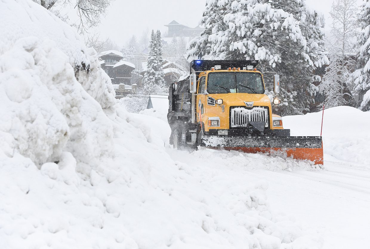 A city plow truck clears snow off of a street in downtown Steamboat Springs Wednesday afternoon. A winter storm passing through the area kept the crews busy most of the day.