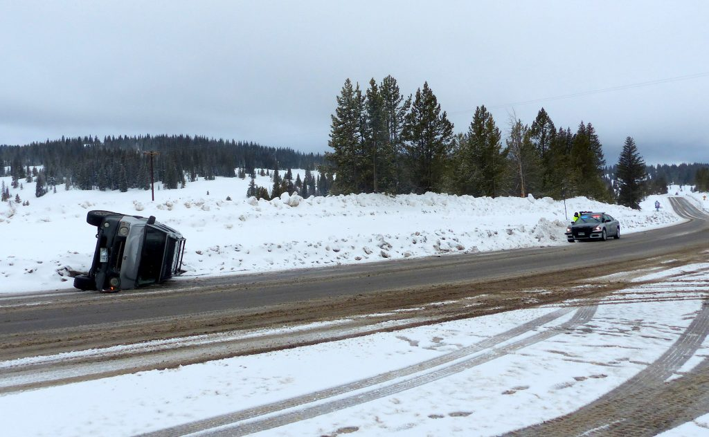 Due to slippery road conditions, a car flipped over along Rabbit Ears Pass.