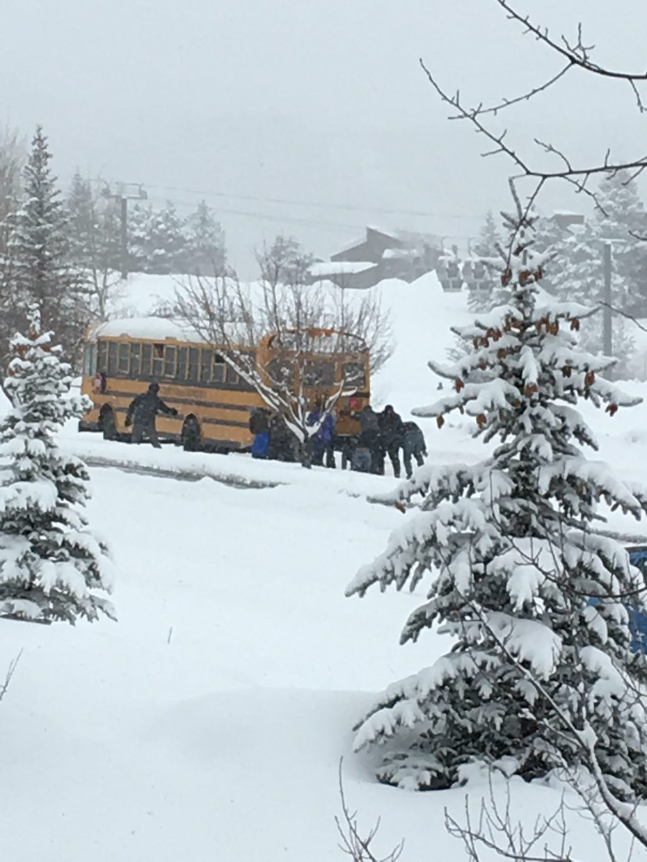 Pushing a school bus on Mount Werner Road.