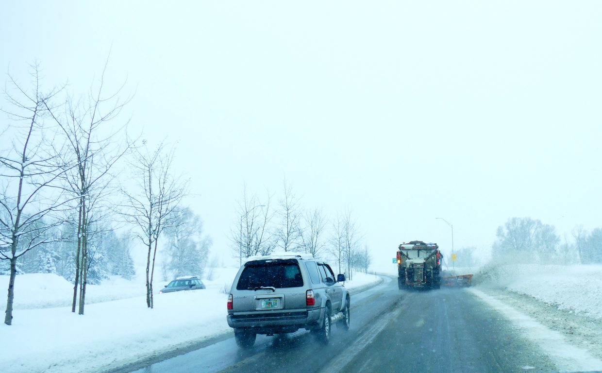 The snowplows are working very hard to keep the streets clear in Routt County. This snowplow is on Hwy 40 in Steamboat.