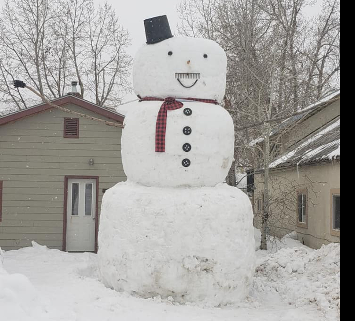 Giant snowman made by Jeremiah Bush and his son.