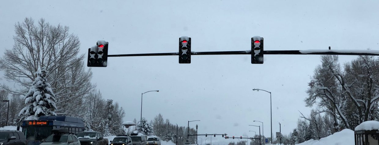 Streetlights blink slowly in pouring snow in downtown Steamboat Springs.