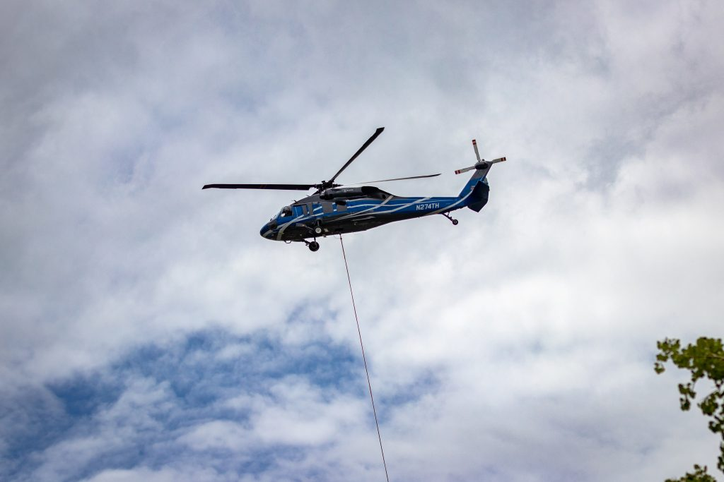 A shot of the helicopter helping Steamboat Resort remove gondola towers.