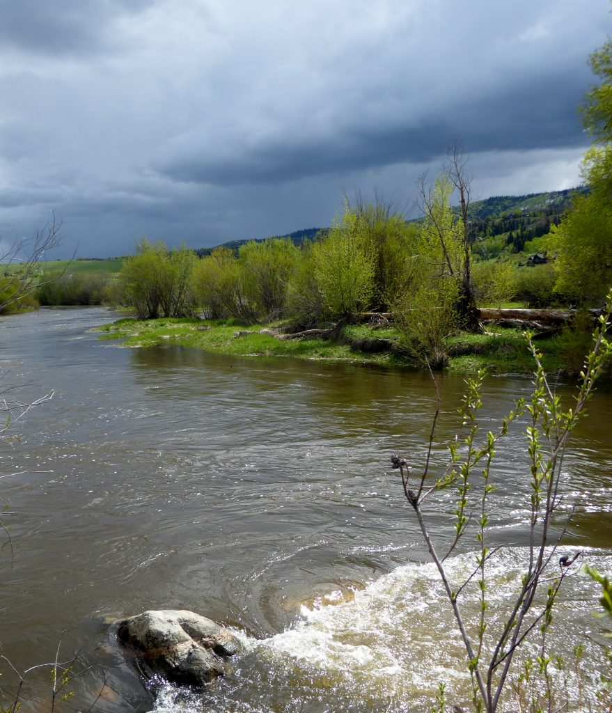 Storm clouds brew over the Yampa River.