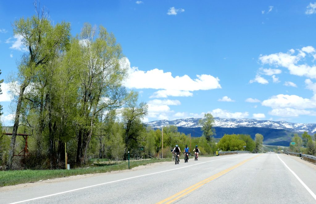 Here are some nice pictures of Steamboat resort, from far away down the Yampa Valley, and some cyclists on Hwy 40, between Steamboat west to Milner.
