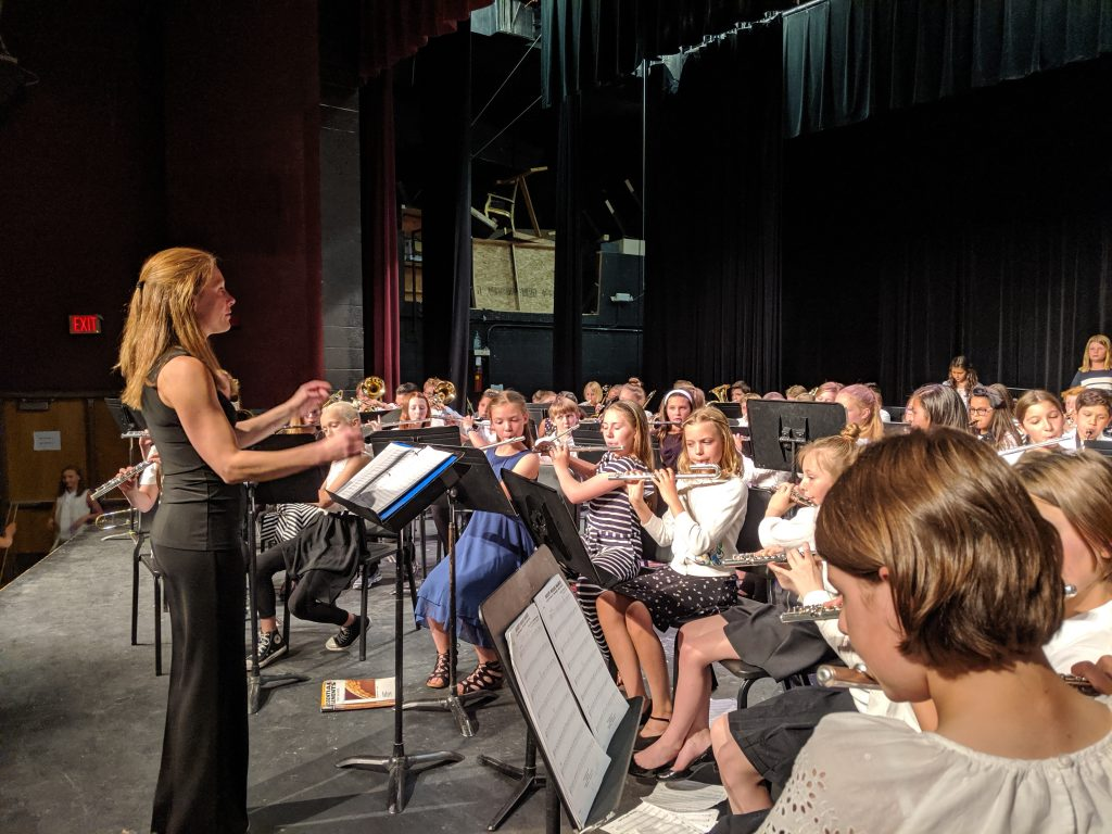 Corinne Sommerfeld, music teacher at Strawberry Park Elementary, conducts the combined Strawberry Park and Soda Creek 5th Grade Band last night at Steamboat High School.