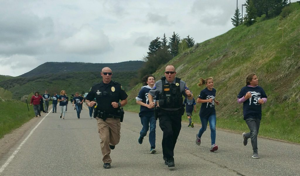Participants from the Law Enforcement Torch Run in Oak Creek. Runners included South Routt Middle School students and staff, Special Olympic Athletes, Oak Creek Police Department Officers, Oak Creek Fire Protection District firefighters, Routt County Sheriff's Office deputies and Colorado State Patrol officers.