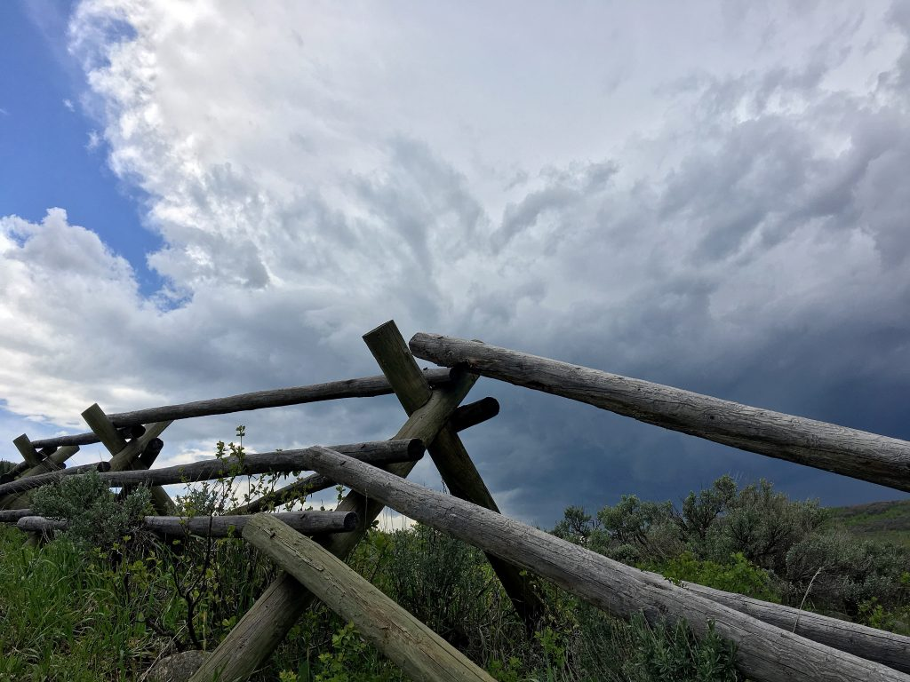 Clouds gather over the fence posts along Mad Creek.