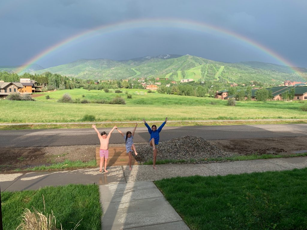 A rainbow dances over Steamboat Springs.