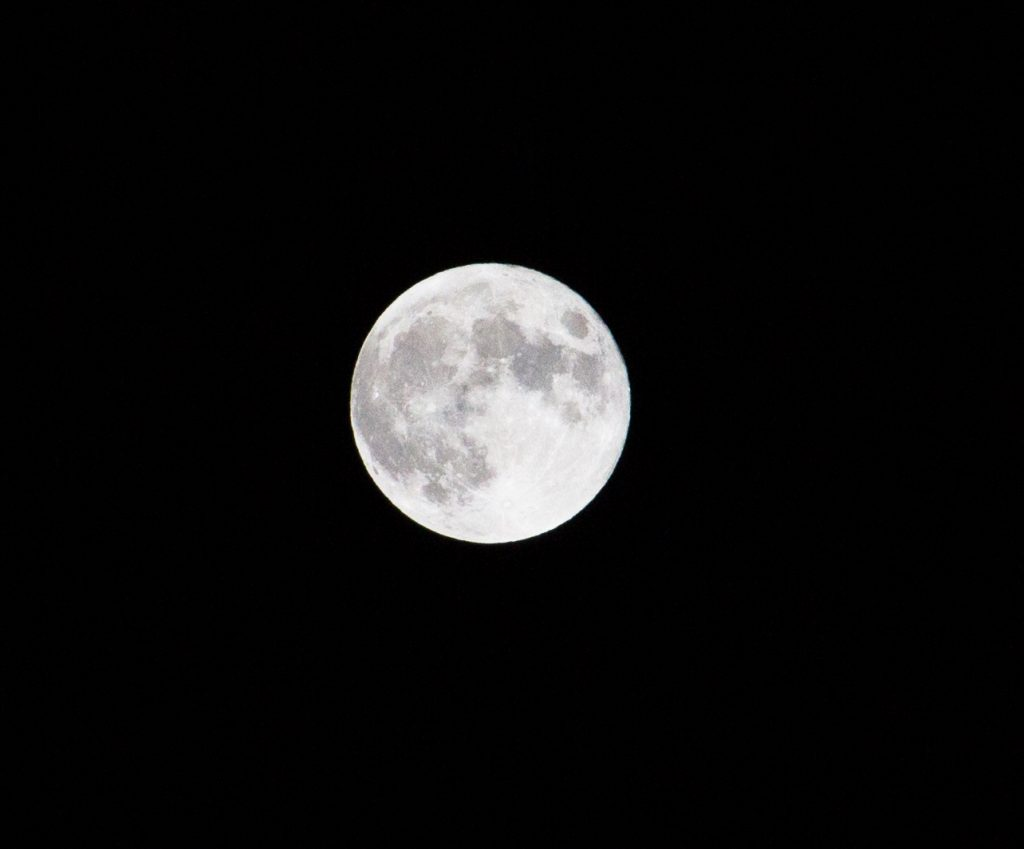 A full moon rises over Steamboat Springs.