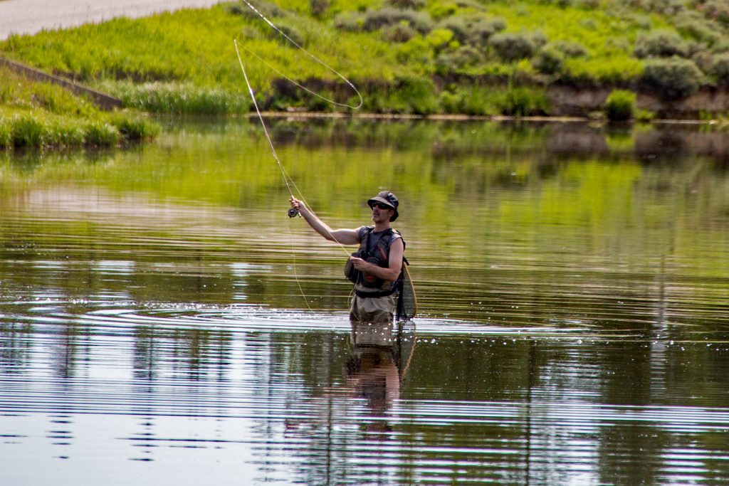 A man fly fishes in Steamboat Lake on Saturday, Aug. 3.